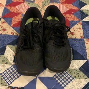 Black running Nike sneakers